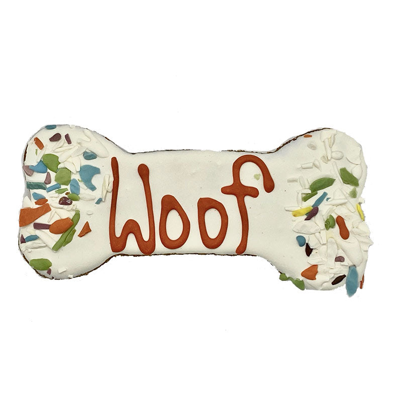 One Andy's Dandys Honey Oat flavor large bone shaped baked dog biscuit fully dipped in white yogurt icing with yogurt sprinkles and woof design