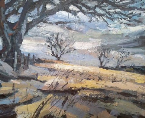 Painting of a tree overhanging a pale gold and brown field with a wintery white and purple sky by Cornwall artist Jill Hudson at the Byre Gallery