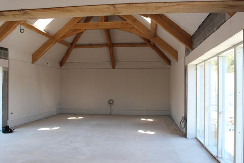 wooden beams in the ceiling of a newly constructed building