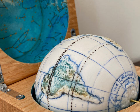 close up detail of a small globe in an oak box by Loraine Rutt of the Little Globe Company