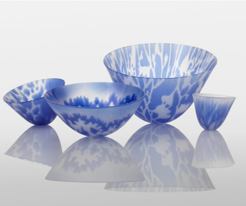 a collection of blue and transparent glass bowls by glass artist Verity Pulford