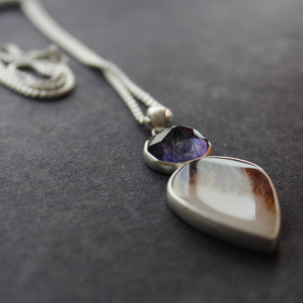 Sliver pendant with purple faceted stone set above tear shaped agate, both set in silver on silver chain