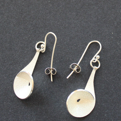 Textured silver curved and circular earrings by Beverly Bartlett