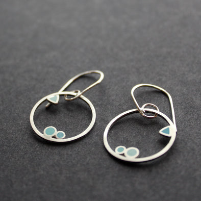 silver hoop earrings with blue detail made by  Clare Lloyd.