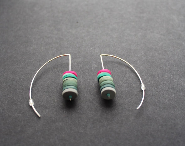 a pair of Clare Lloyd - stacked disc earrings in soft greens and cerise