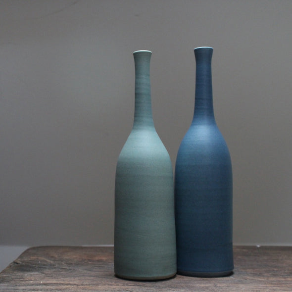 Two ceramic bottles one pale teal, the other darker teal by Lucy Burley at the Byre Gallery
