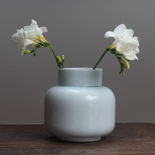 Pale Green ceramic vase by ceramicist Laura Plant with freesias