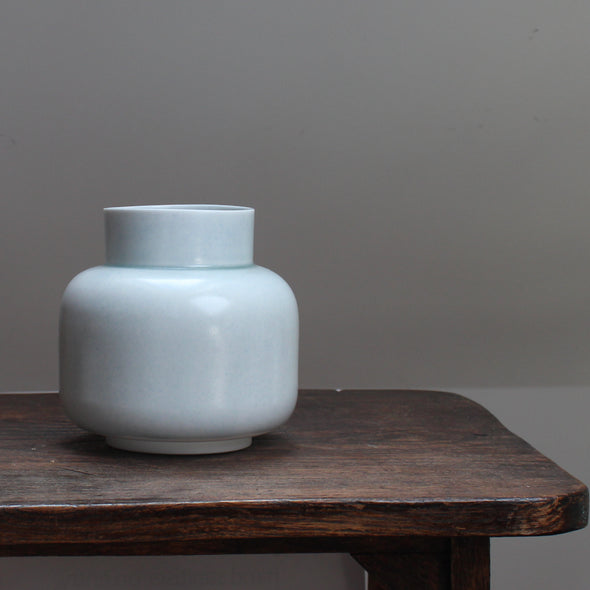 Pale Green vase on a wooden table