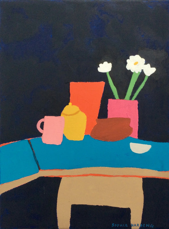 Painting of a blue cafe table with brightly coloured cups and teapot and vase of flowers. By Sophie Harding