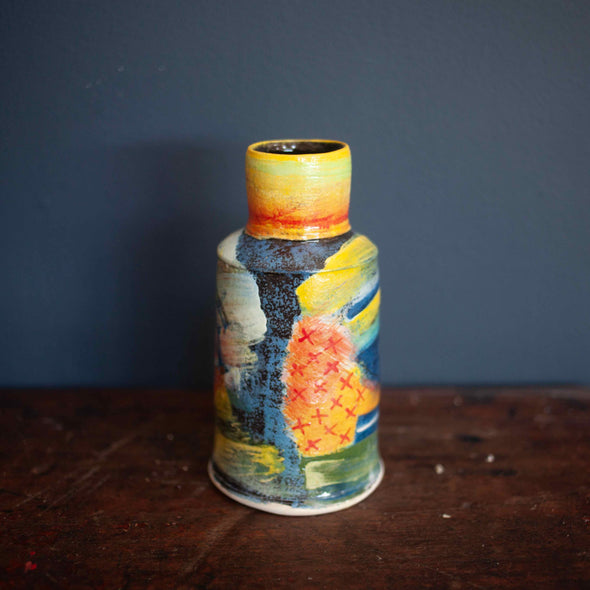 A colourful vase by John Pollex