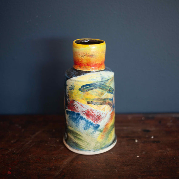 A Colourful vase by John Pollex with narrow top