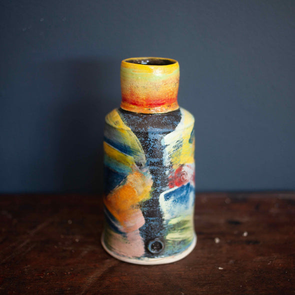 Colourful vase by John Pollex with narrow top