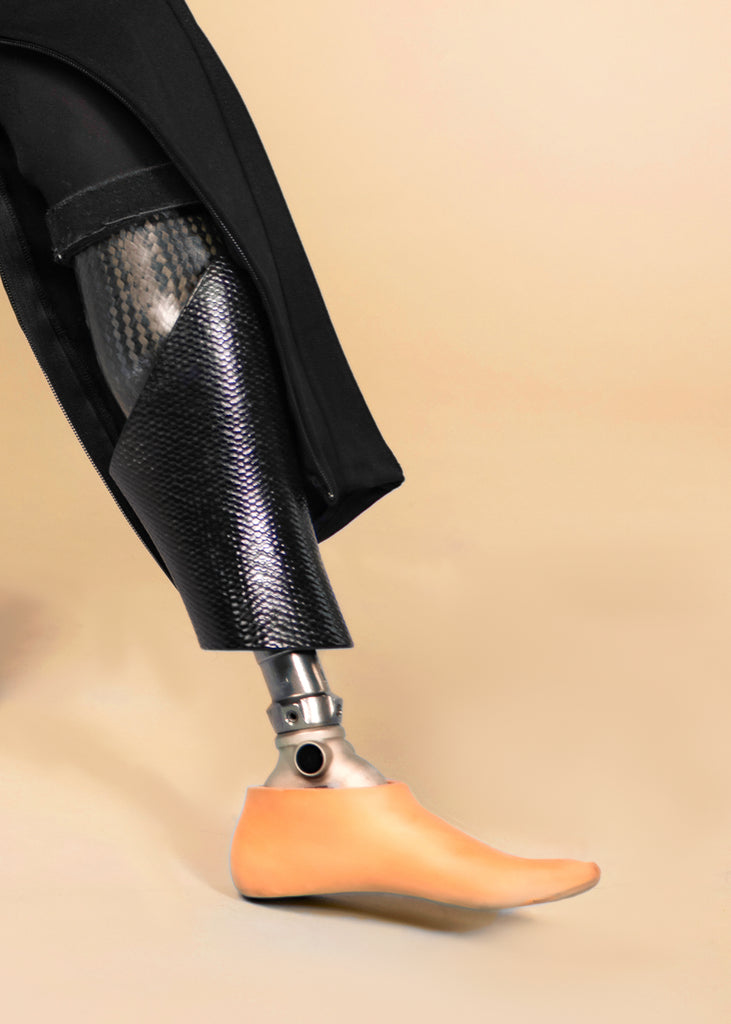 Close up photo of prosthetic leg and foot revealed by special zipper opening of the Unite-able Magnolia pant.