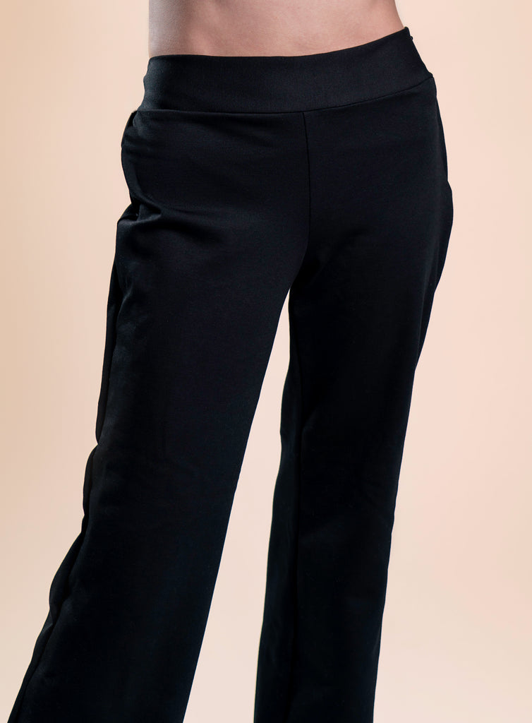 Close up front view of black Unite-able hyacinth pants on standing model.
