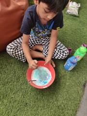 child working with a diy kit