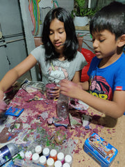 Girl and a boy getting messy with diy kits