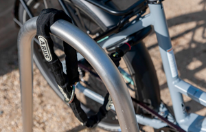 ABUS Frame Lock Chain attached to the frame lock on a CERO bike and wrapped around a bike rack