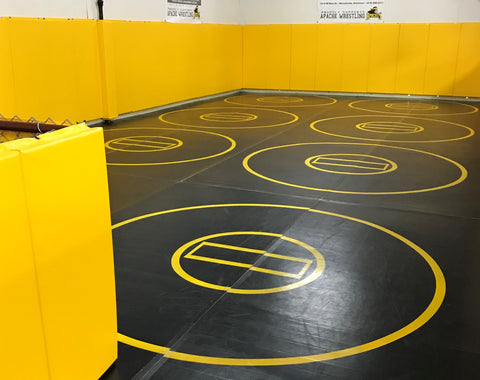 Black practice mat with yellow circles and wall pads