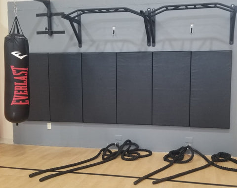 Black gym wall safety panels