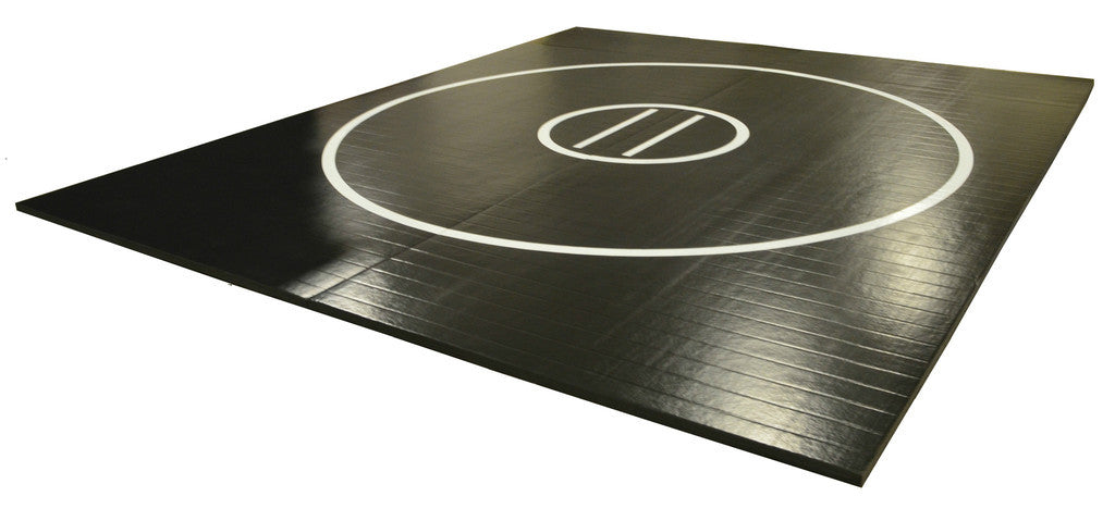 Black wrestling mat with white circles for sale by AK Atheltics