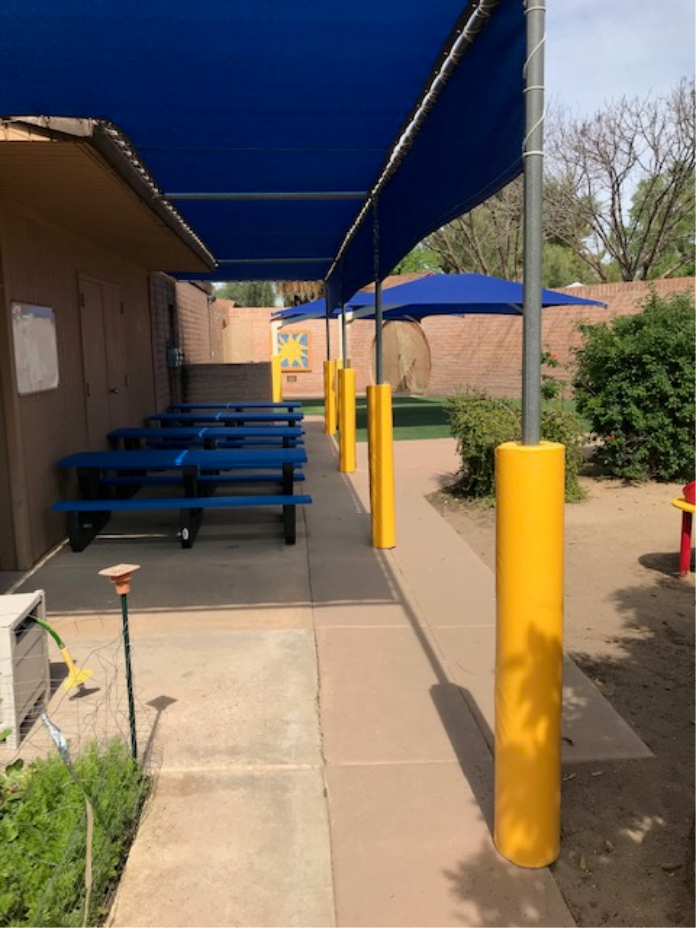 Yellow Safety Pole Pads at Elementary Playground