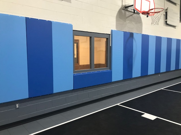 Alternating blues basketball padding for detention center