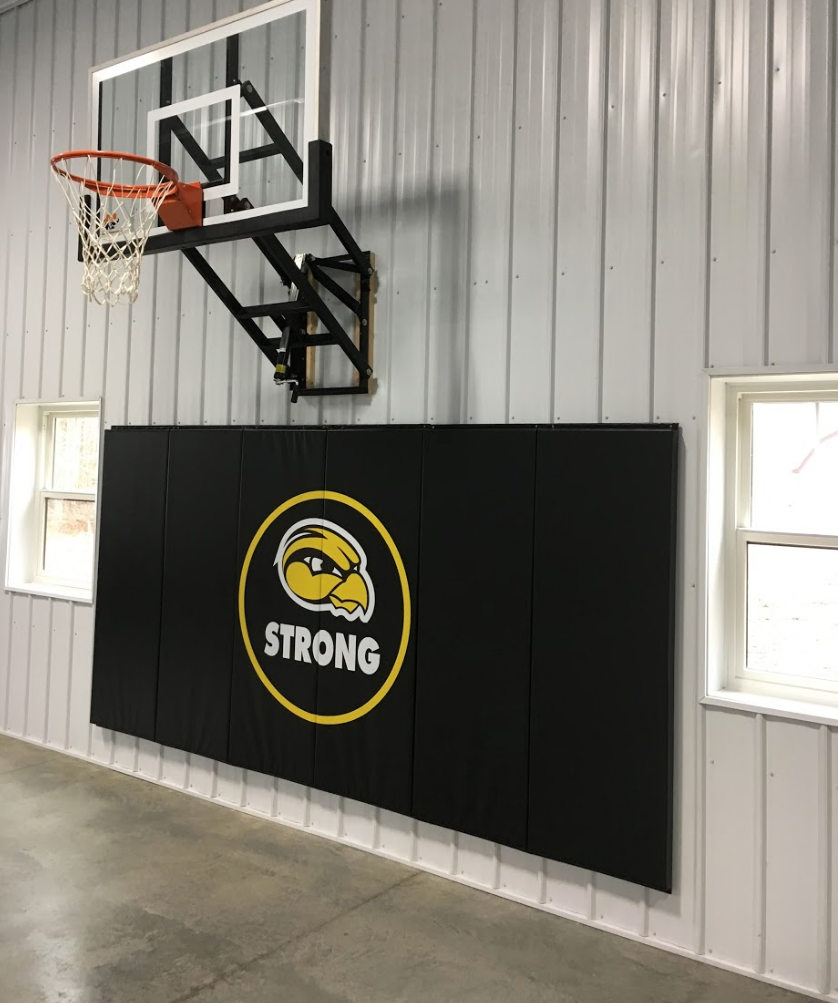 AK Athletics Logo on School Gym Wall Padding