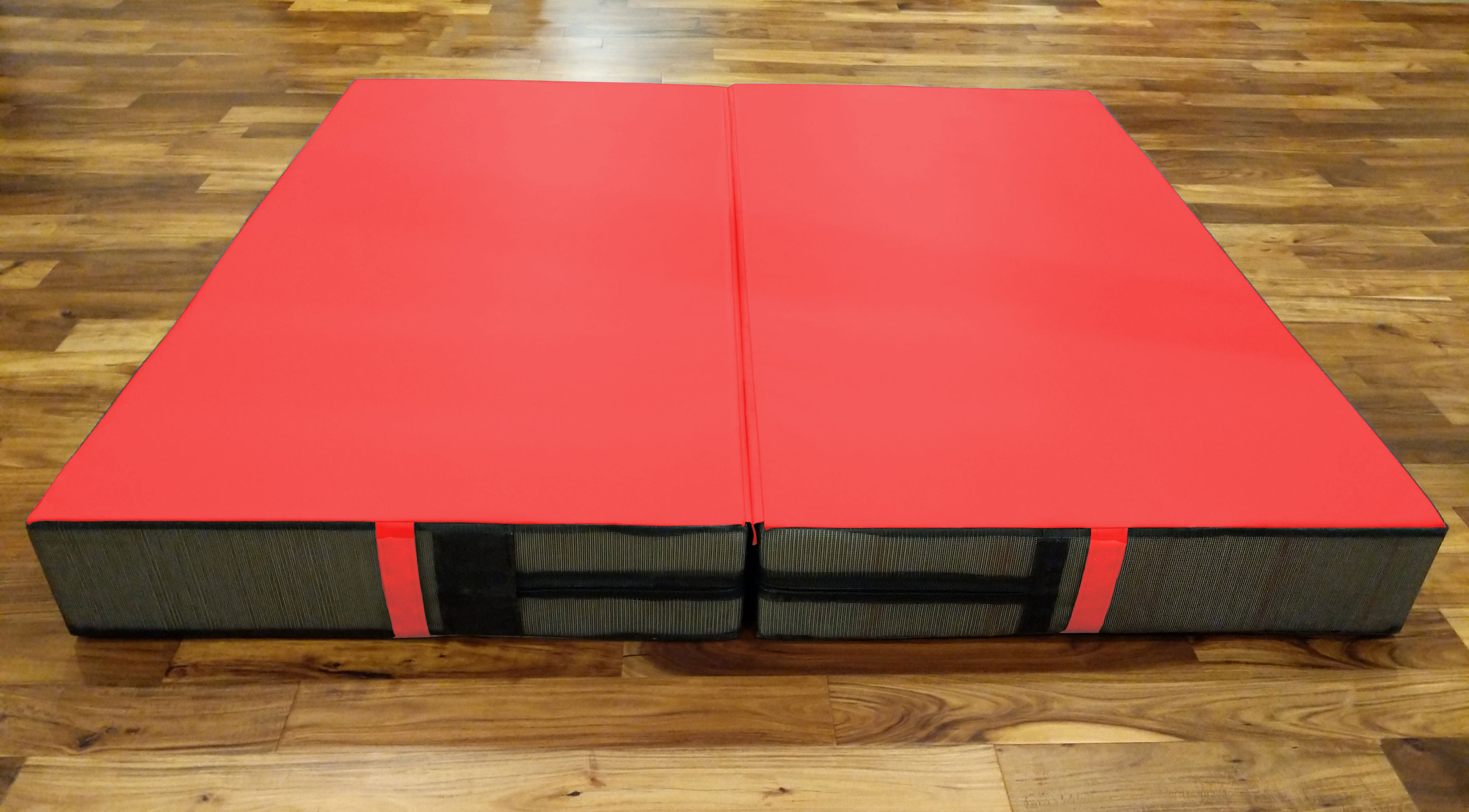red acrobatic crash mat