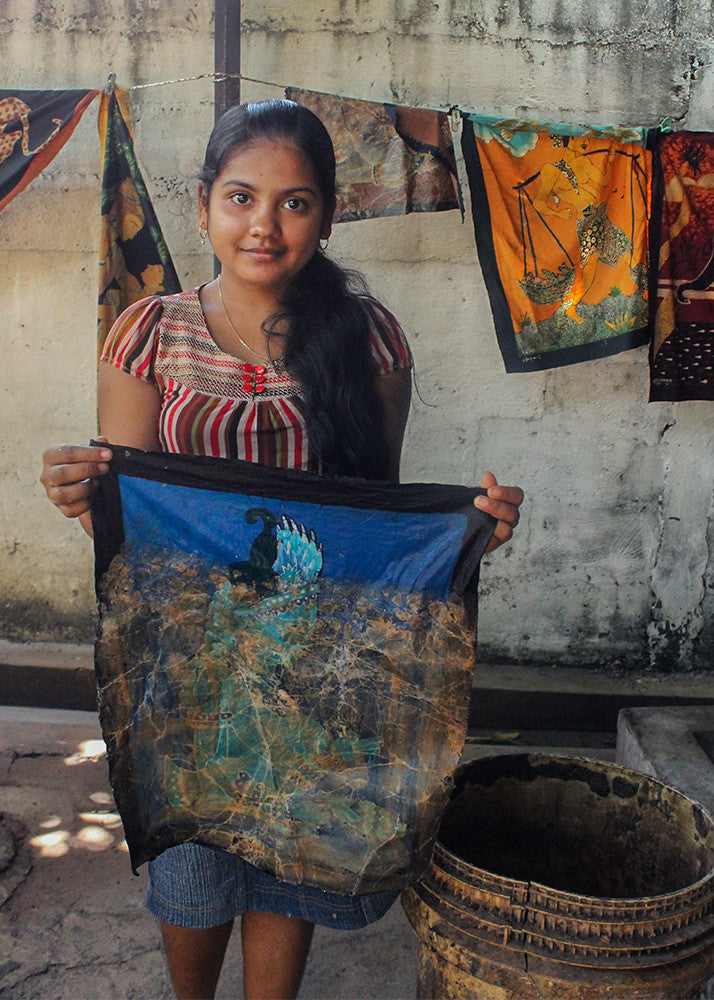 An artisan demonstrates the batik tapestry process