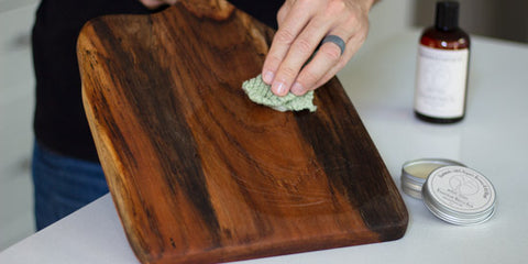 Applying Arbor Novo's Miracle Balm to a wood serving board.