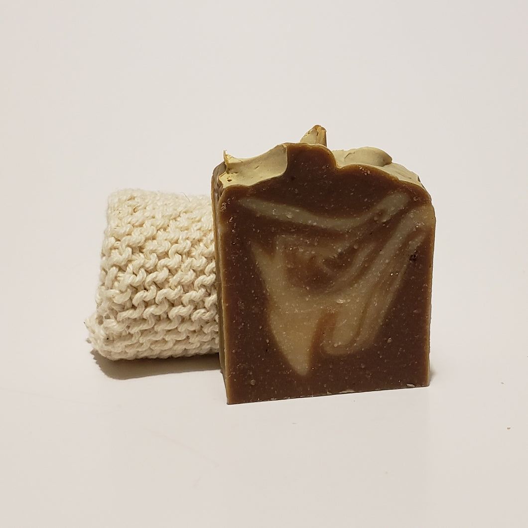 Swirly brown soap next to a cloth