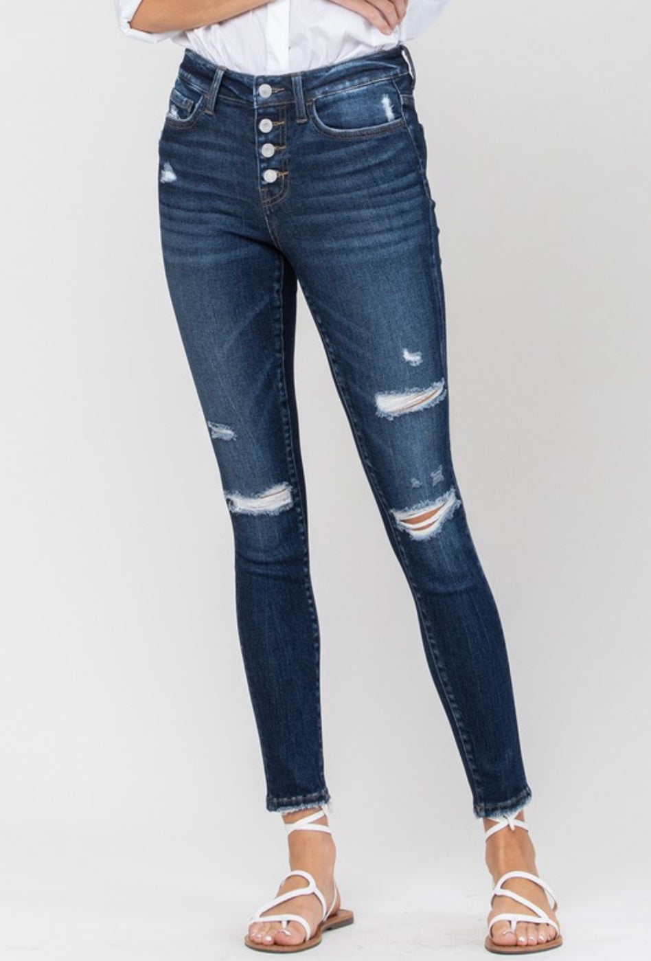 Mid Rise Distressed Button Up Skinny Jeans