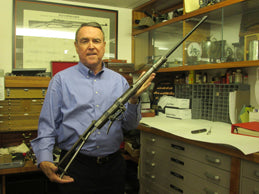 Bruce Canfield holding Melvin Johnson original prototype firing mechanism that he developed and was the basis for his famous M1941 semiautomatic rifle