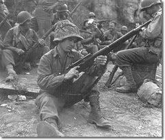 Pfc. Edward J. Foley of the 143rd Infantry, 36th Division, cleaning his M1903A4 sniper rifle before moving out to the front lines near Velletri, Italy, May 29, 1944.  (National Archives)