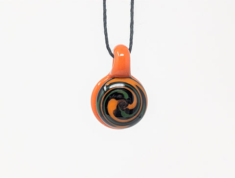 Wigwag Orange, Black, & Green Colored Glass Pendant Necklace with Solid Orange Backing
