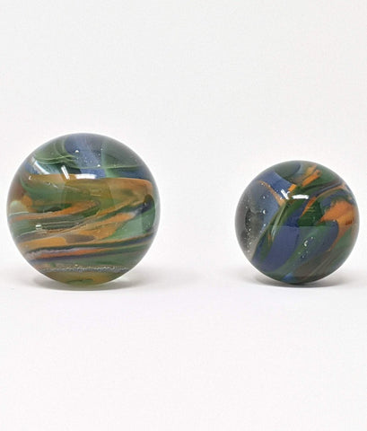 Mixed colors of orange, blue, green, and clear borosilicate glass marbles