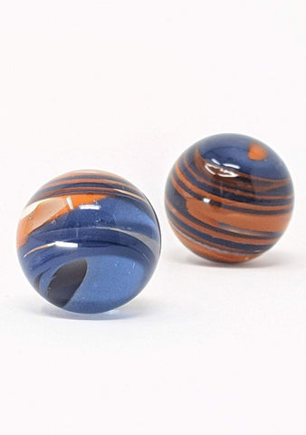 Set of glass marbles with orange and blue colored glass