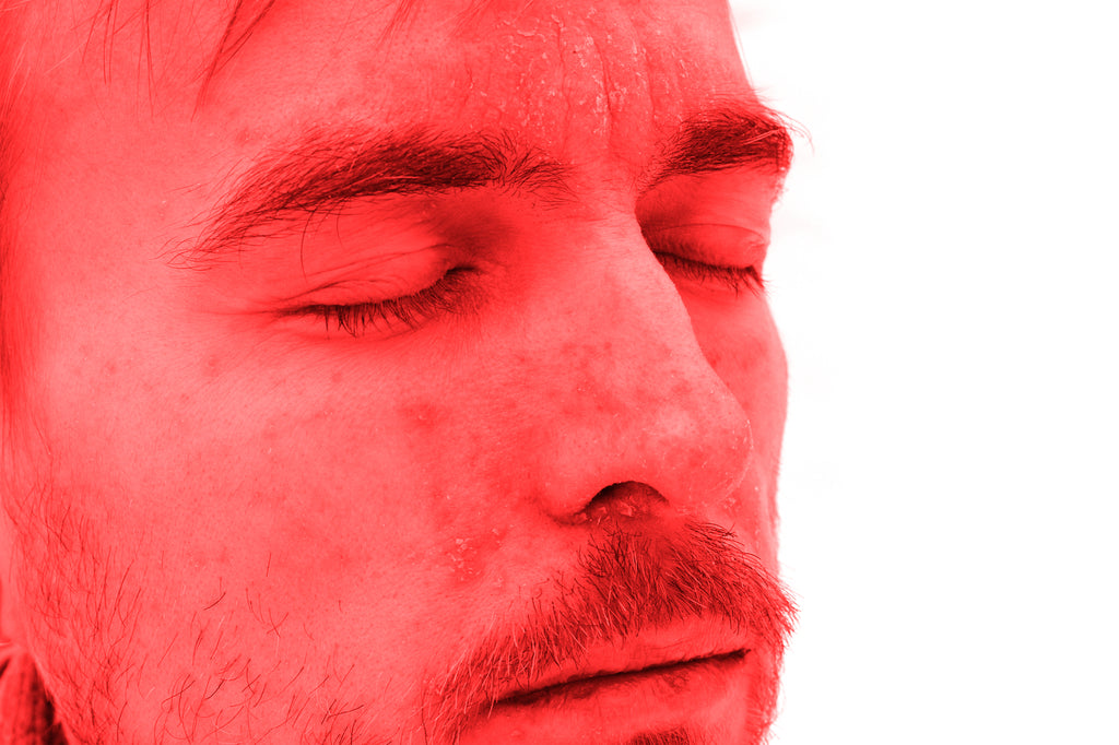 Man undergoing red light therapy for facial Psoriasis