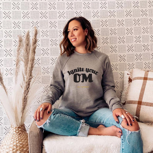 Radiate good energy in our Ignite Your OM Classic Crew Sweatshirt, featuring a rib crewneck, raglan sleeves, and 'Ignite Your OM' front graphic printed with eco-friendly inks. Relaxed, slightly oversized fit. Made with 50% cotton and 50% polyester for ultimate coziness.