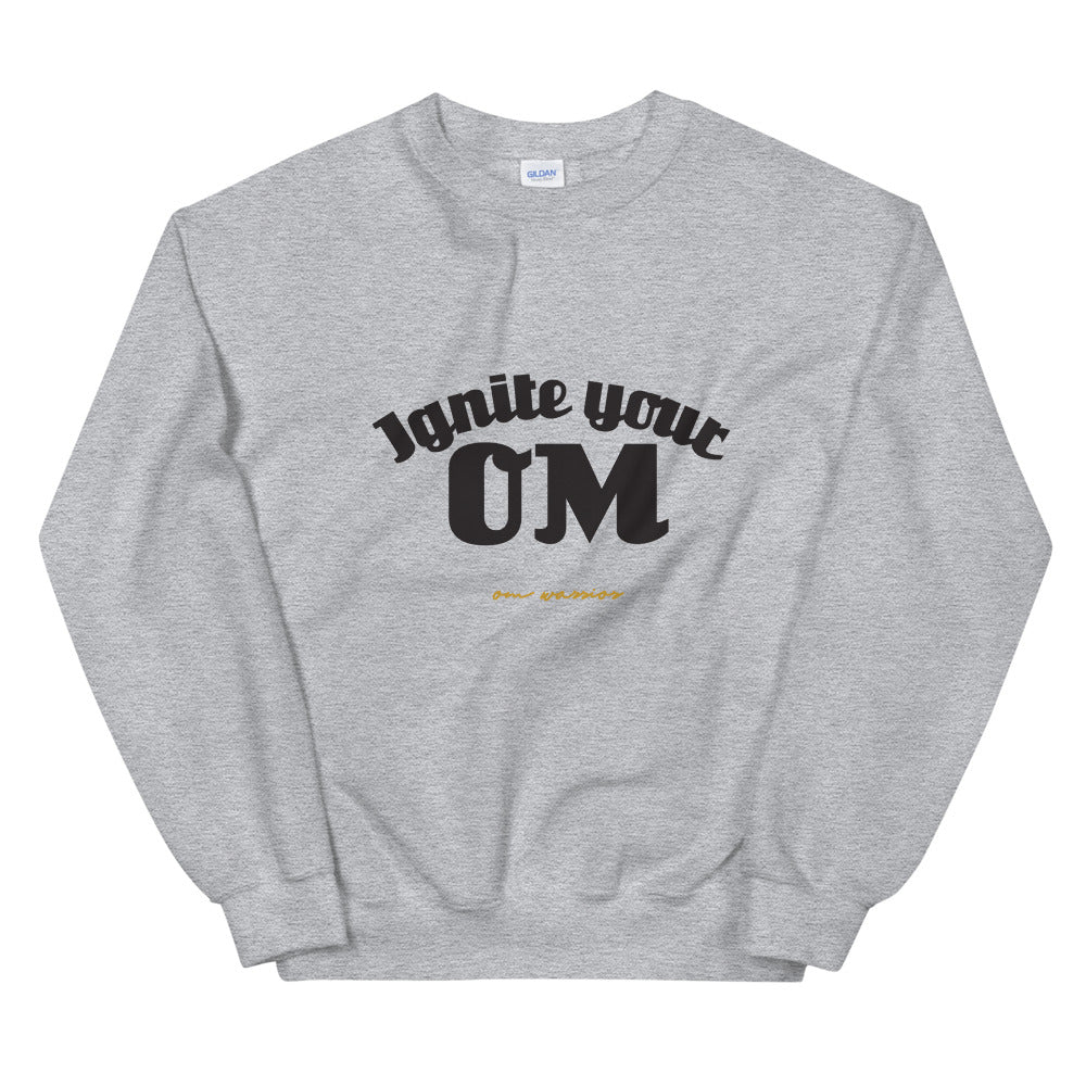 Ignite Your OM Unisex Sweatshirt (Color Heather Sport Grey) - Radiate good energy in our Ignite Your OM Classic Crew Sweatshirt, featuring a rib crewneck, raglan sleeves, and 'Ignite Your OM' front graphic printed with eco-friendly inks. Relaxed, slightly oversized fit. Made with 50% cotton and 50% polyester for ultimate coziness.