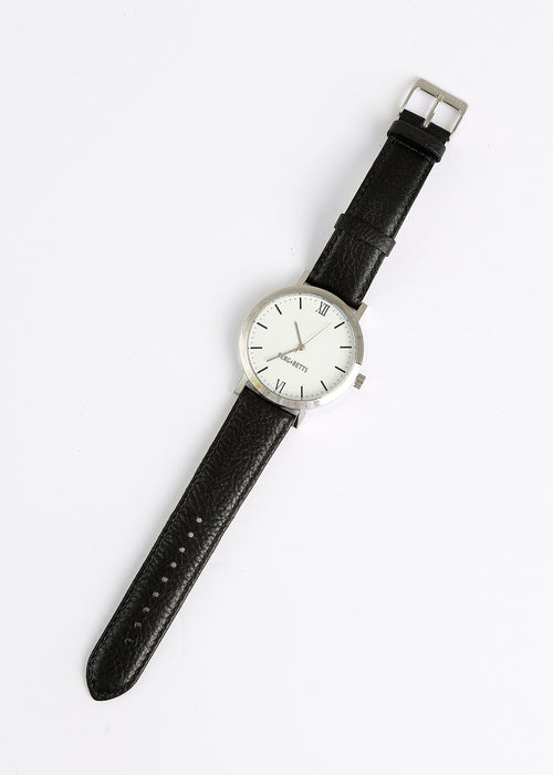 Berg + Betts Black and Silver Round Watch — New Classics Studios