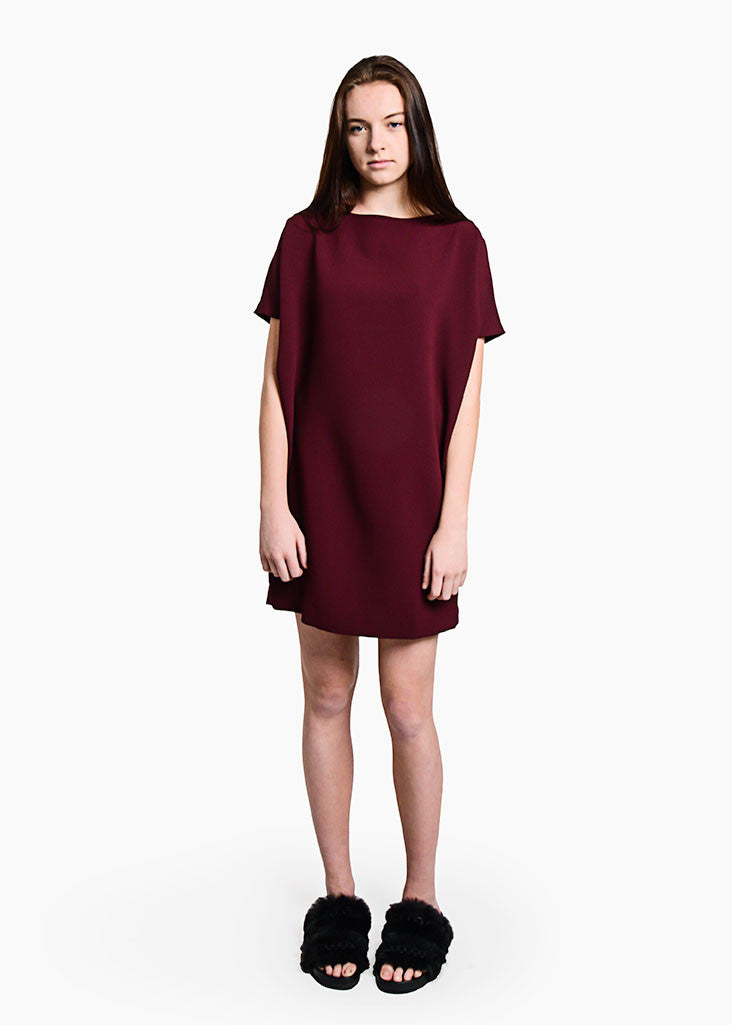 Kaarem Burgundy Angle Mini Dolman Open Back Dress from New Classics Studios. We Ship worldwide from Canada.