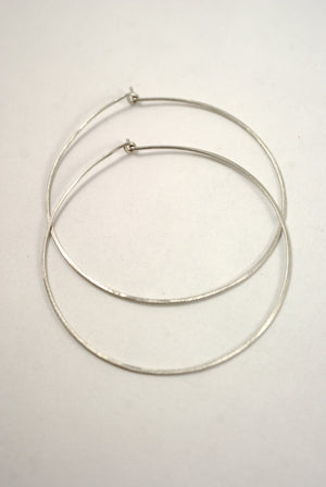 Minimalist hoops lightly hammered earrings sterling silver | Pipe and Row