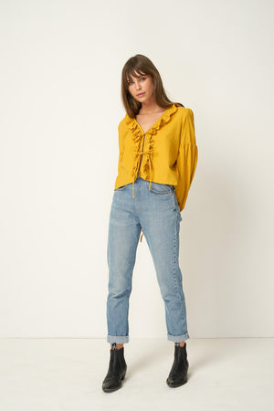 Rue Stiic Tahoe ruffle tie shirt in sahara mustard yellow Pipe and Row boutique