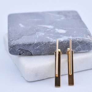 gold baton earring with jacket fresh tangerine pipe and row seattle