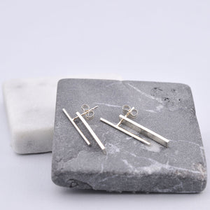 silver baton earring with jacket fresh tangerine pipe and row seattle