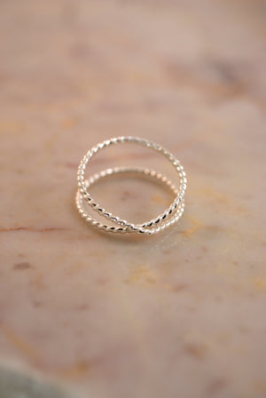 best selling statement stacking ring dainty minimal modern Twisted X ring sterling silver handmade | Pipe and Row