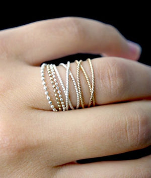 Textured twisted wraparound stacking rings 14k gold jewelry | PIPE AND ROW