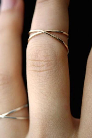 Hannah Naomi hammered X ring gold | pipe and row