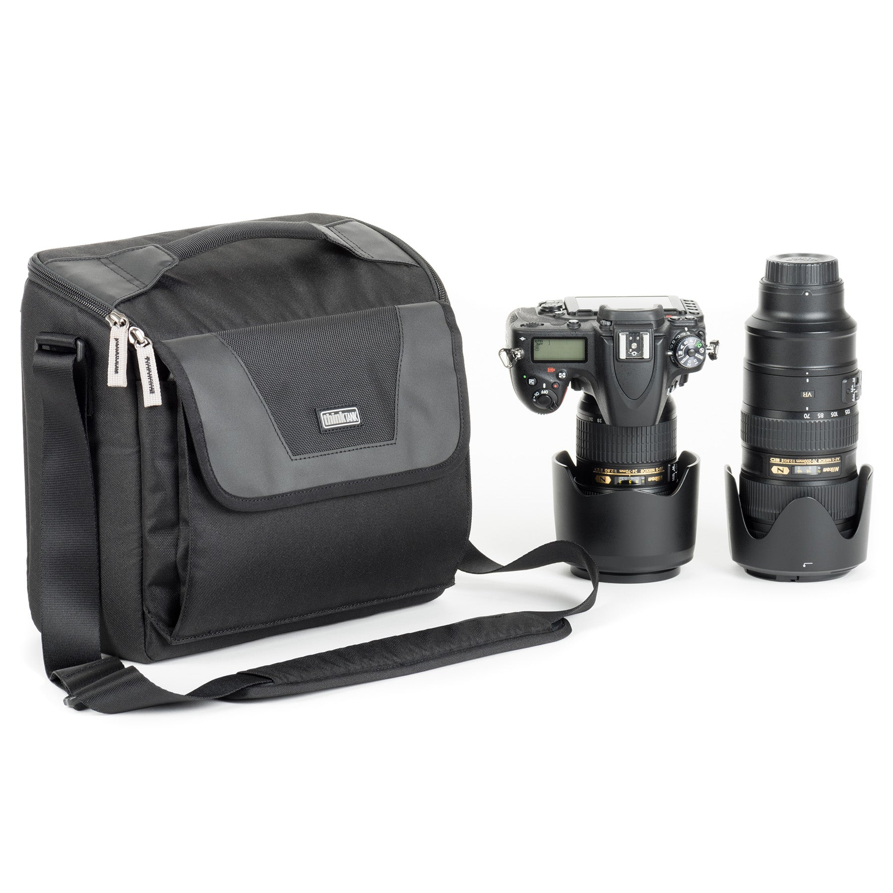 "Fits an ungripped DSLR or Mirrorless camera body, 2‒4 standard telephoto lenses with hoods attached and reversed, and a 10"" tablet."